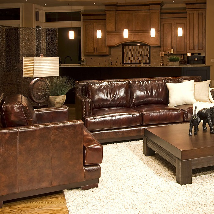A Glass And Gold Bar Cart Brown Leather Armchair And: Emerson Top Grain Leather Sofa And Chairs Set In Saddle