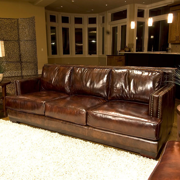 A Glass And Gold Bar Cart Brown Leather Armchair And: Emerson Top Grain Leather Sofa In Saddle Brown