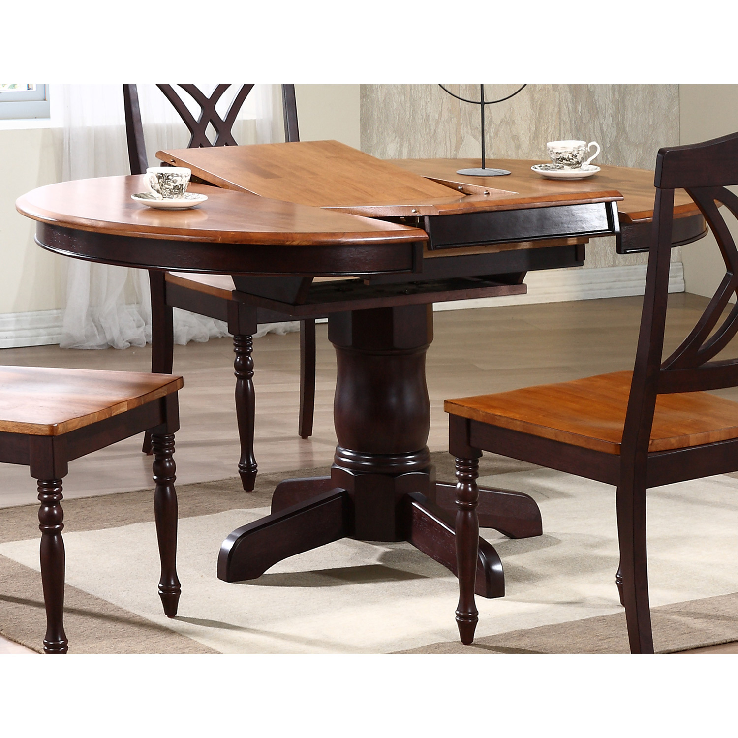 Cyrus extending dining table round top pedestal base two tone icon