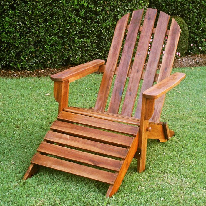 marketta wooden adirondack outdoor chair with footrest dcg stores. Black Bedroom Furniture Sets. Home Design Ideas